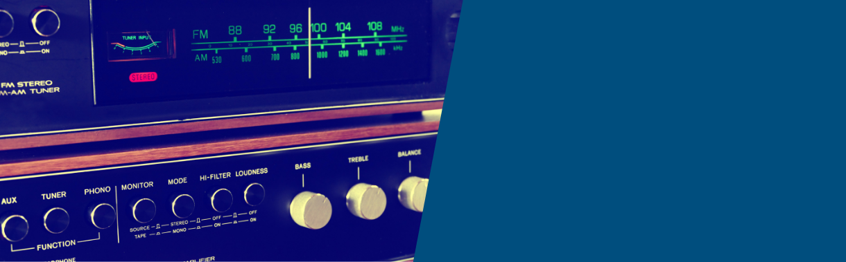 A radio with dials, used as a background image to promote available interviews from Ben's Country Music Show which you can listen to right here on the website.
